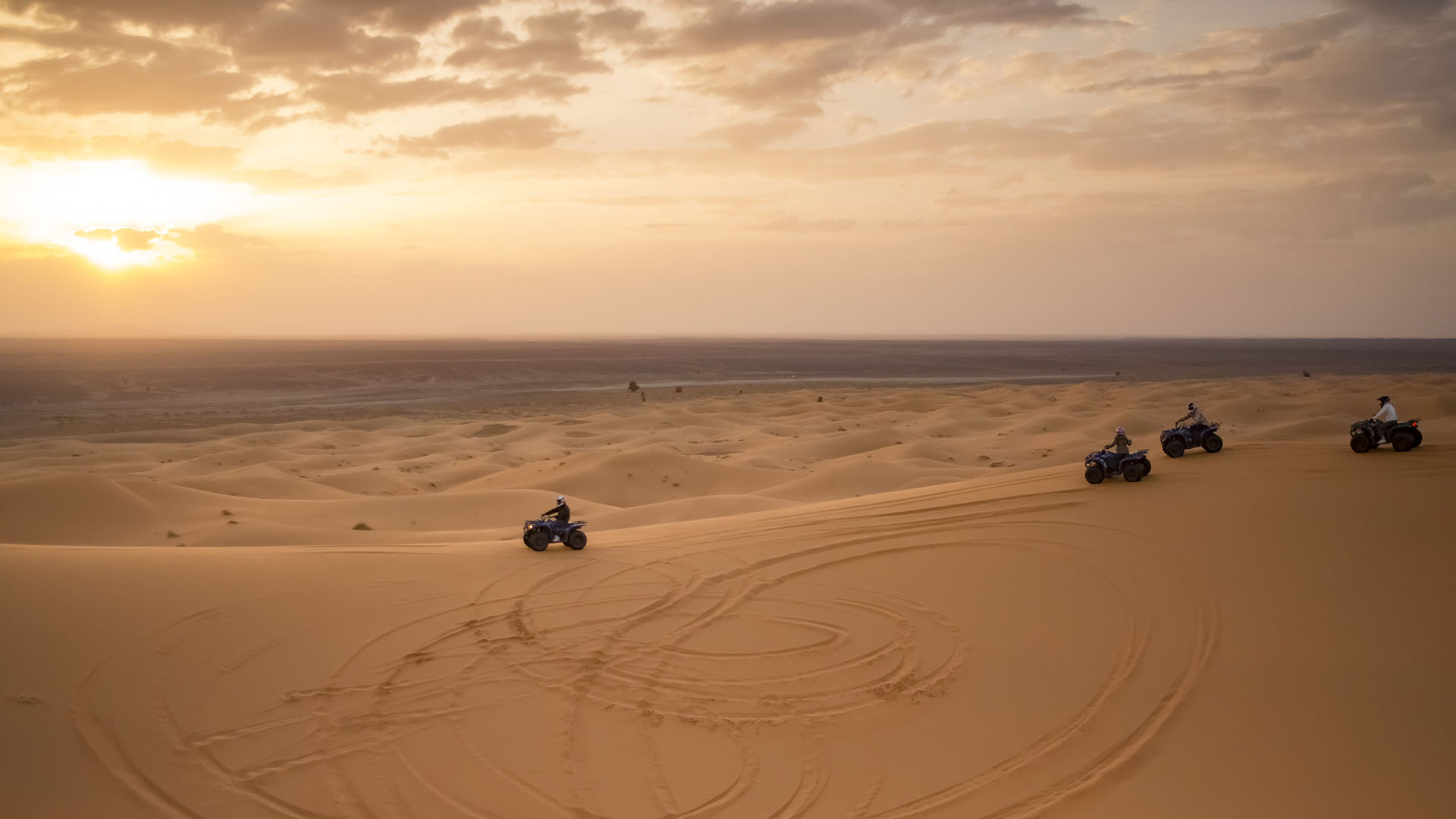 Quads during the sunset in Erg Chebbi, Merzouga - Rooms, photo by Ezyê Moleda, all rights reserved